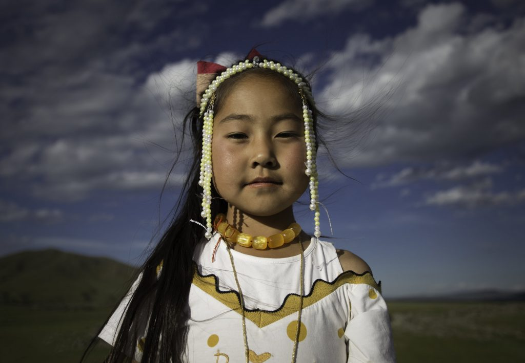 Art and activism. Young girl in ethnic dress